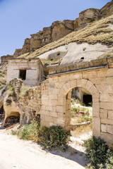 """Urgup. Ruins of  facades of the old  """"cave"""" city on the rocks"""