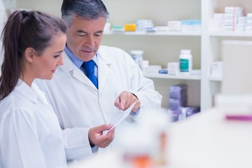 Pharmacist explaining a prescription to his trainee