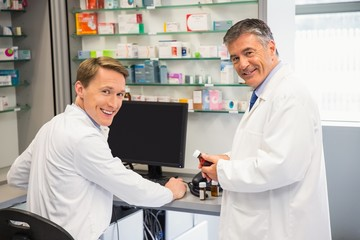 Team of pharmacists using the computer