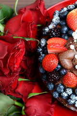 Dark Red Roses and Chocolate Cake with Berries