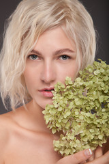 Blonde woman with flower
