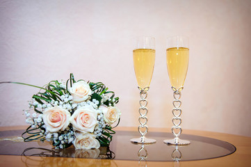 two glasses of champagne with wedding