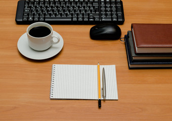 keyboard, cup of coffee and office supplies