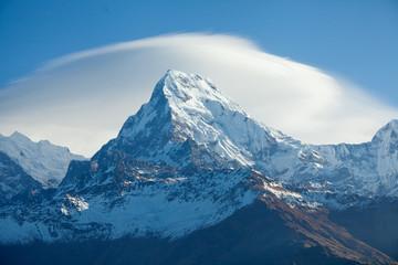 Mountain peak Annapurna South At Sunrise In Himalayas