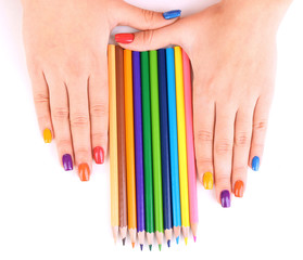 Multicolor female manicure with colored pencils isolated