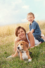 Family with dog have a calm leisure time outdoor
