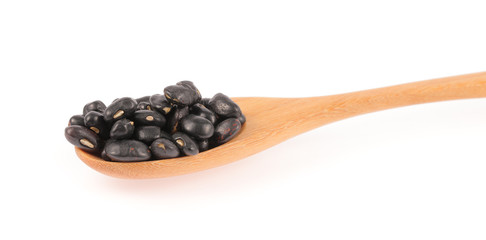 Mung beans in wooden spoon