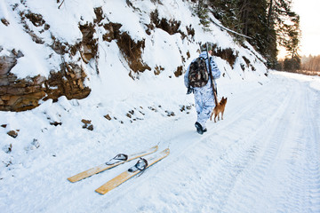 hunter with skis on the road