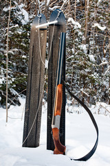 sporting gun and skis