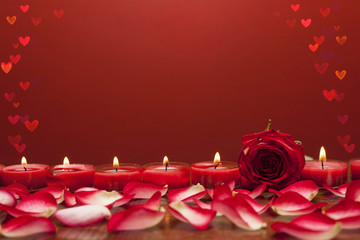 Fototapete - Red rose with candles and flower petals