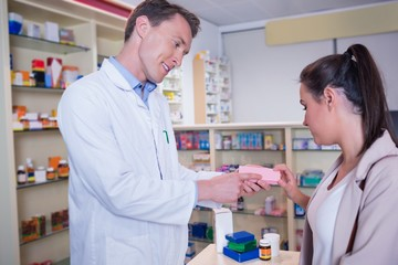 Pharmacist and customer discussing a product