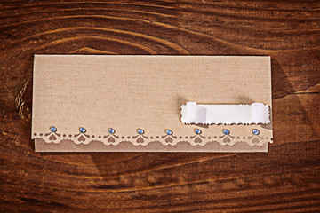 envelope for invitation on wooden table