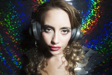 beautiful sexy disco dj woman in silver costume