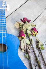 Dry roses and ukulele.