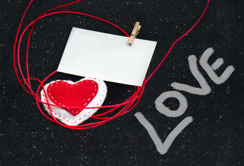 Heart of fabric on a black background. Symbol of love.