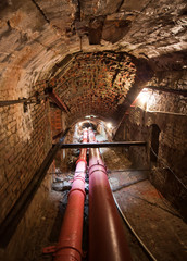Underground pipeline tunnel, arched brick walls and ceiling