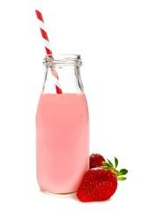 Fotobehang Milkshake Strawberry milk with straw in a bottle with berries
