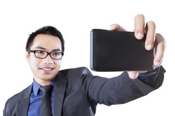 Asian entrepreneur taking self picture