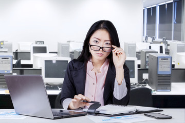 Female worker with schedule book in office