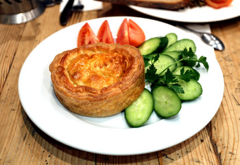 Chicken pie with vegetables photographed closeup