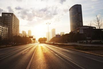 modern city road scene at sunset Fotomurales