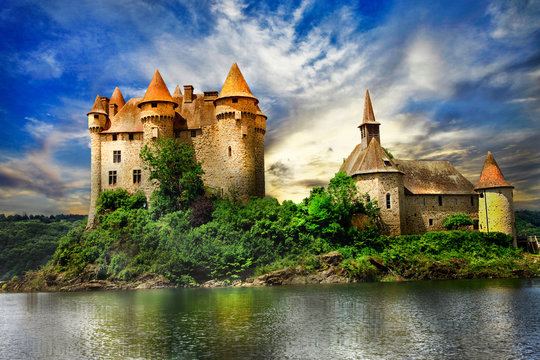 fairy castle on lake over sunset - chateau de Val, France