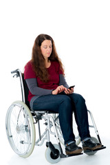 young woman in wheelchair with smartphone