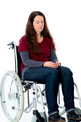 sad young woman in wheelchair