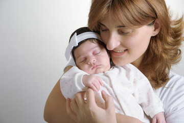 happy mother with newborn baby closeup