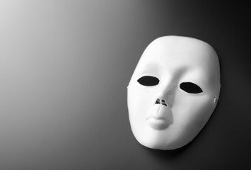 Theater mask on grey