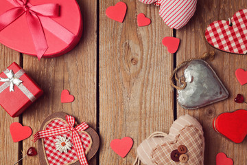 Valentine's day background with heart shapes on wooden table