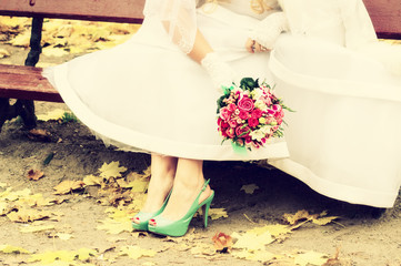 Bride in bright clothes on the bench