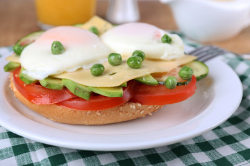 Sandwich with poached eggs, cheese and vegetables