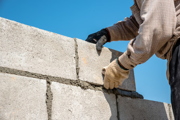 worker build concrete wall by cement block and plaster  Wall mural
