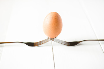 balanced egg with fork
