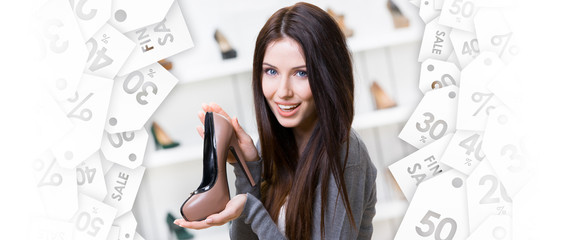 Portrait of woman keeping coffee-colored leather shoe in shopping center. Black Friday sale