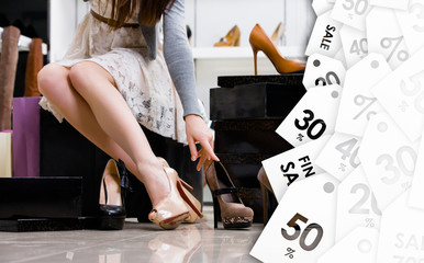 Female legs and variety of shoes in the footwear shop. Clearance sale