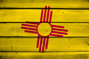 New Mexico State Flag on wood background