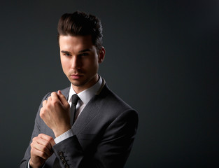 Trendy young man in modern business suit