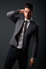 Cool male fashion model with shirt and tie