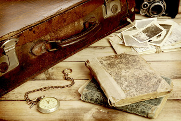 old suitcase, books, photos in retro style