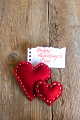 Red hearts on wooden background, valentine's day