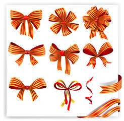 Set of red and gold gift bows with ribbons.