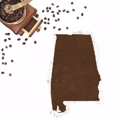 Coffee powder in the shape of Alabama and a coffee mill.(series)