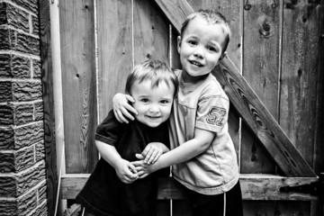 Two Happy Boys Hugging - Black and White