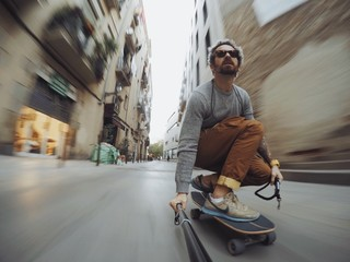 Man rides through city on skateboard
