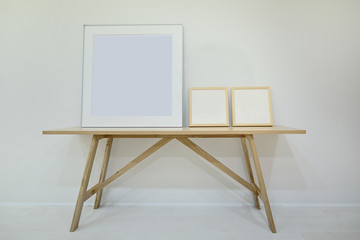 Three empty decorative frame for paintings or photographs on the