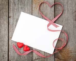 Valentine's day blank gift card and red candy hearts