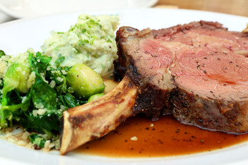 thick juicy portions of grilled fillet steak served with green