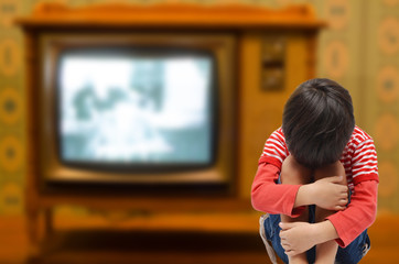 Kid sitting with sadness and sick from tv addict need love from